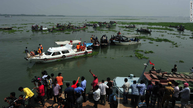 Rescue workers search for missing passengers Tuesday after a ferry accident in Bangladesh's Munshiganj district.