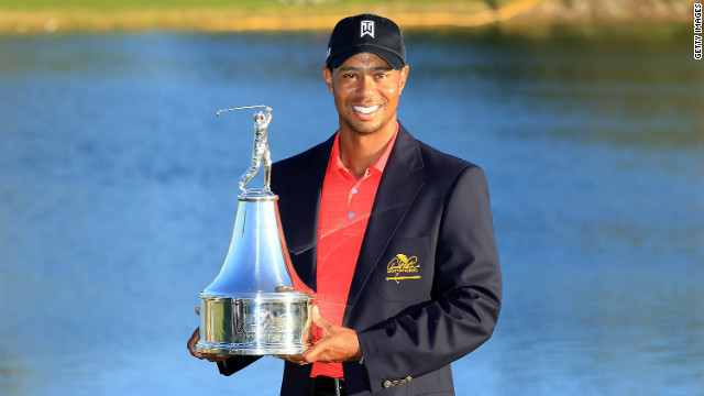 Tiger Woods displays the trophy on Sunday after winning the 2012 Arnold Palmer Invitational in Orlando, Florida.