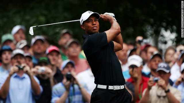Tiger Woods hits a shot during a practice round Tuesday as he prepares for the 2012 Masters Tournament.