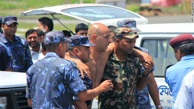 An Agni Air plane crash survivor is evacuated for medical attention to Pokhara Airport on May 14, 2012.