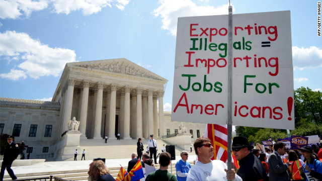 A supporter of Arizona's immigration policy pickets outside the U.S. Supreme Court in Washington in April.