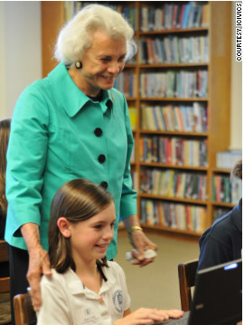 Retired U.S. Supreme Court Justice Sandra Day O'Connor helps a student learn as she plays a game on iCivics.
