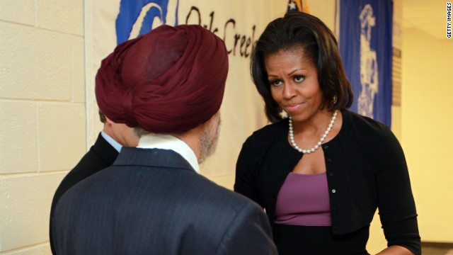 """Michelle Obama greets Sikh community representative Dr. Kulwant Singh Dhaliwal on Thursday in Oak Creek, Wisconsin."" (source: CNN)"