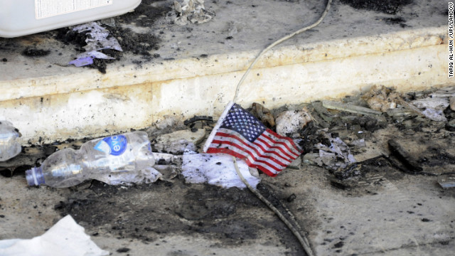 A small American flag is seen in the rubble at the U.S. Consulate on Wednesday.