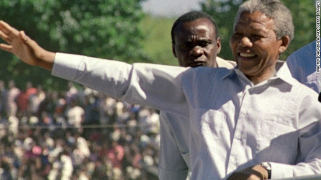 Mandela and Zambian President Kenneth Kaunda arrive at an ANC rally on March 3, 1990, in Lusaka, Zambia. Mandela was elected president of the ANC the next year.