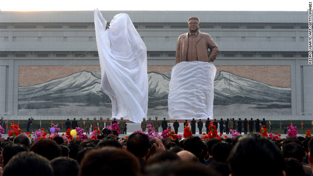 A crowd watches as statues of the nation's founder, Kim Il Sung, and his son Kim Jong Il are unveiled during a ceremony in Pyongyang on April 13, 2012. Photos from North Korea are rare, but the country was on full display in April 2012 as it celebrated the 100th birthday of Kim Il Sung.
