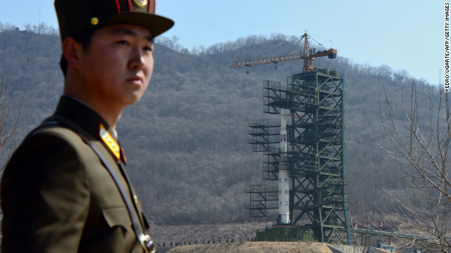 A North Korean soldier stands guard in front of an UNHA III rocket at the Tangachai-ri Space Center on April 8, 2012.