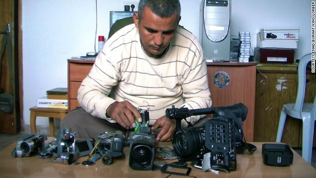 Co-director Emad Burnat with his five broken cameras