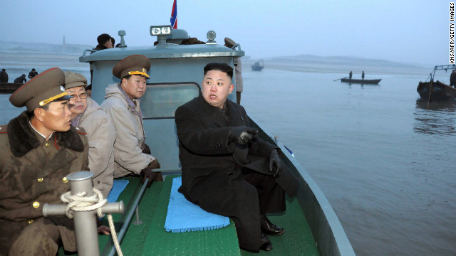 Kim arrives at Jangjae Islet by boat to meet with soldiers of the Jangjae Islet Defense Detachment near Taeyonphyong Island in South Hwanghae province on March 7.