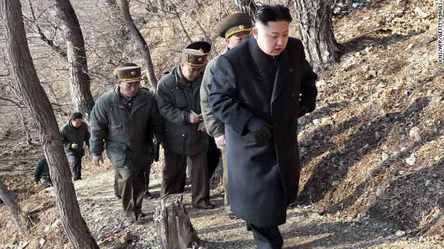 Kim makes his way to an observation post with North Korean soldiers on March 25.