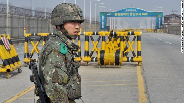 A South Korean soldier stands on a road linked to North Korea at a military checkpoint in Paju on Wednesday, April 3. After a week of threats to the United States and South Korea, North Korea blocked hundreds of South Korean workers from entering the industrial complex, which is an important symbol of cooperation between the two countries.