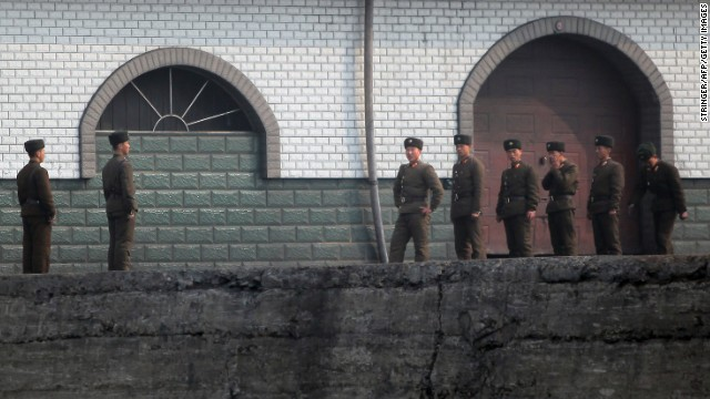 North Korean soldiers gather by the docks in Sinuiju near the Chinese border on Thursday, April 4.