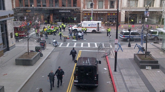 The blasts occurred a few seconds apart on opposite sides of the street, CNN Producer Matt Frucci reported.