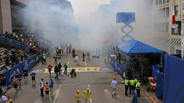 Smoke billows after two explosions go off near the finish line.