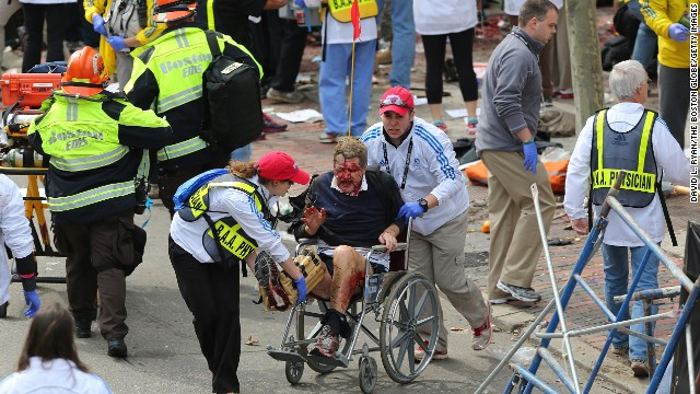 A person who was injured in an explosion near the finish line of the Boston Marathon is taken away from the scene in a wheelchair on Monday, April 15. <a href='http://www.cnn.com/2013/04/15/us/boston-marathon-explosions/index.html'>Read our developing news story</a> and follow up-to-the-minute reports <a href='http://news.blogs.cnn.com/2013/04/15/explosions-near-finish-of-boston-marathon/'>on CNN.com's Just In blog</a>.