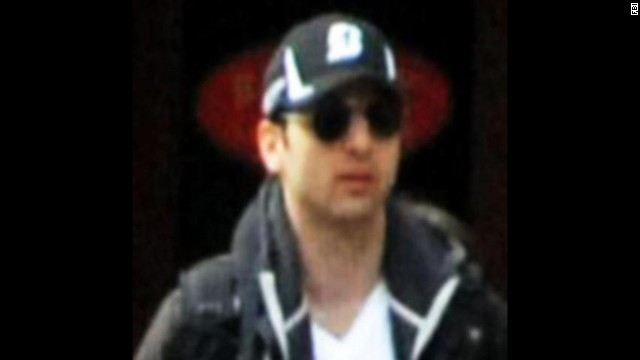 The FBI on Thursday, April 18, released photos and video of two men it called suspects in the deadly bombings at the Boston Marathon and pleaded for public help in identifying them. This is Suspect 1, Tamerlan. He and his brother were photographed walking together near the finish line of the marathon before the explosions.