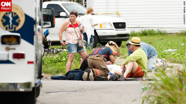A victim is helped by bystanders and first responders after a shooting at a Mother's Day parade in New Orleans on Sunday.