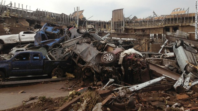 Extensive damage from an EF4 tornado destroyed cars and demolished structures in Moore on May 20.