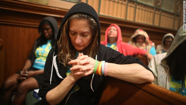 People wear hoodies during services remembering Trayvon Martin at Middle Collegiate Church in New York on Sunday, July 14.