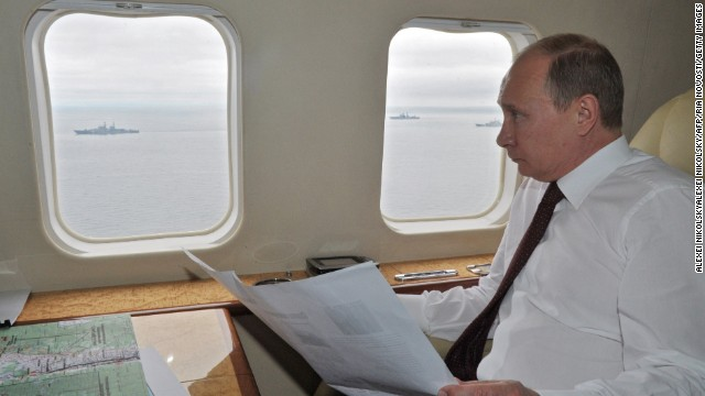 Russian President Vladimir Putin inspects military exercises near Sakhalin Island in the Pacific Ocean, on Tuesday, July 16.