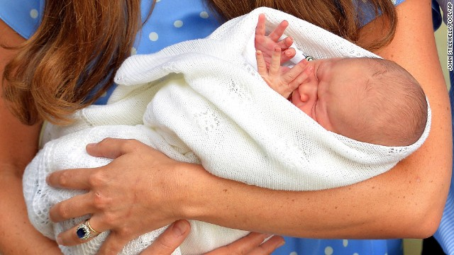Catherine holds the baby outside the hospital for the public's first view.