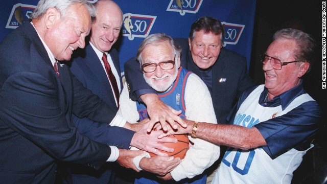 In addition to making NBA history, Ossie Schectman, center, earned All-America honors at Long Island University.