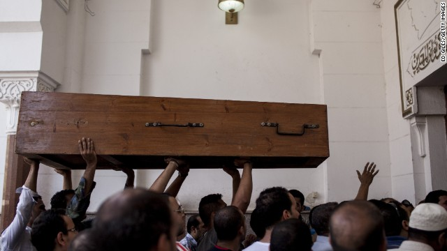 Morsy supporters carry a coffin into a mosque in Cairo's Nasr City on August 15.