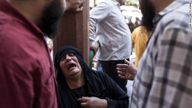 A woman weeps after identifying the body of a relative on August 15 at a Cairo mosque.