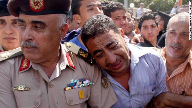 Egyptian policemen attend the funeral for their colleagues on August 15.