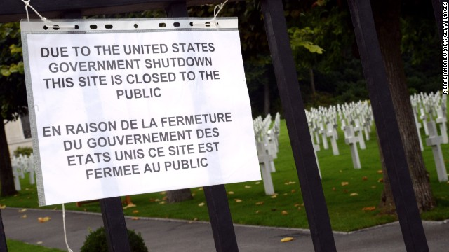 A sign informs visitors that the Suresnes American Cemetery and Memorial, west of Paris, is closed because of the shutdown on October 1.
