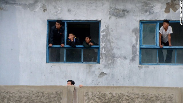 In the city of Rason, people are leaning out of windows to get a glimpse of the Western cyclists.