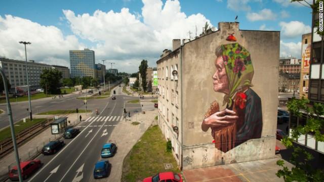 """""""Madam Chicken"""" overlooking a city street in Lodz."""