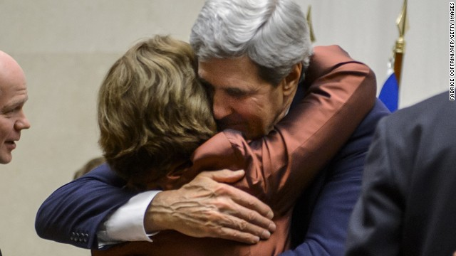 After the agreement was announced, EU foreign policy chief Catherine Ashton and U.S. Secretary of State John Kerry embraced.