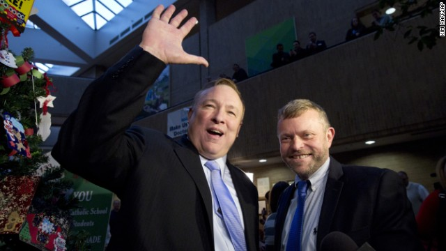 Utah state Sen. Jim Dabakis, left, and Stephen Justesen acknowledge the crowd after being married in Salt Lake City on Friday, December 20. A federal judge struck down Utah's ban on same-sex marriage, saying it conflicted with the constitutional guarantees of equal protection and due process. Many Utah counties began issuing marriage licenses before the state appealed to the U.S. Supreme Court. The high court temporarily blocked enforcement of the lower court ruling until the constitutional questions are fully resolved.