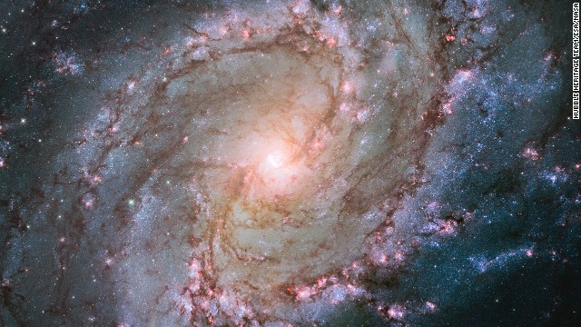 The Hubble Space Telescope captured this image of the Southern Pinwheel Galaxy, one of the largest and closest galaxies of its kind. <a href='http://www.spacetelescope.org/news/heic1403/' target='_blank'>The center of the galaxy is mysterious</a>, researchers say, because it has a double nucleus -- a supermassive black hole that may be ringed by a lopsided disc of stars, giving it the appearance of a dual core.