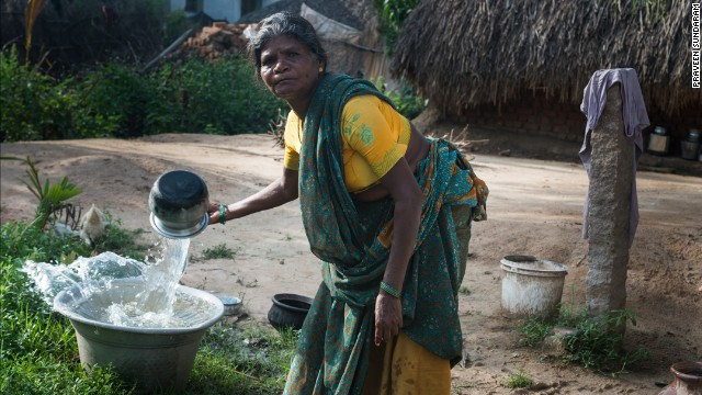 A woman in Vilupuram, India, washes pots and pans at her new water point. With safe water at her home, she no longer has to make daily trips to the river. Matt Damon and Gary White co-founded <a href='http://water.org/' target='_blank'>Water.org</a>, a nonprofit that helps communities achieve sustainable water systems. Click through to see the work they are doing throughout the world: