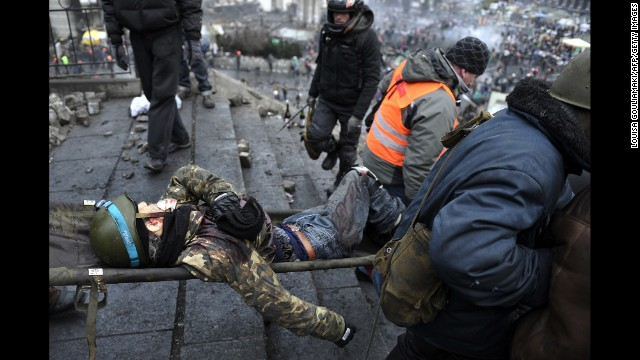 An injured demonstrator is carried away from Independence Square in Kiev on February 20.
