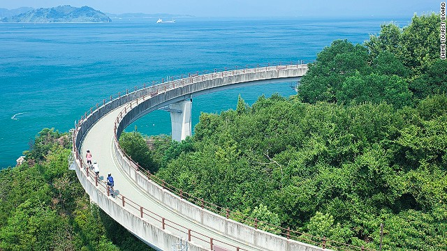 Hiroshima's Shimanami Kaido is a 60-kilometer-long road and bridge network connecting several islands while offering astonishing views of the Seto Inland Sea National Park.