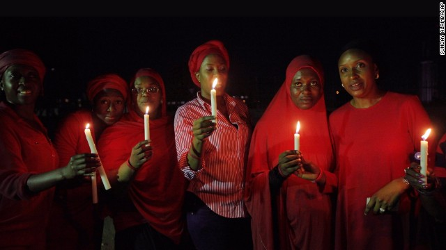 Women in Abuja, Nigeria, hold a candlelight vigil on Wednesday, May 14, one month after nearly 300 schoolgirls were kidnapped by the Islamist militant group Boko Haram. The abductions have attracted national and international outrage.