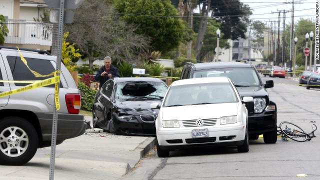 "A police officer inspects the car of the suspected gunman Saturday, May 24, after deadly shootings in Isla Vista near the University of California, Santa Barbara. The suspect, described as mentally disturbed and possibly bent on retribution, sprayed bullets from his car Friday night, May 23, killing six people in a rampage called ""premeditated mass murder,"" Santa Barbara County sheriff's deputies said. The shooter also died."