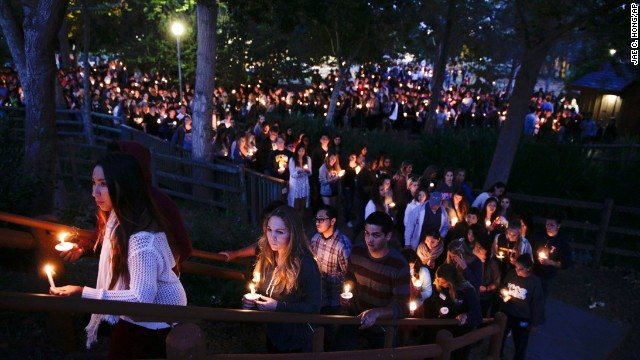 People gather at a park for a candlelight vigil on May 24 to honor the victims of Friday night's mass shooting in Isla Vista, California. Sheriff's officials say Elliot Rodger, 22, went on a rampage near the University of California, Santa Barbara, stabbing three people to death at his apartment before shooting and killing three more in a nearby neighborhood.
