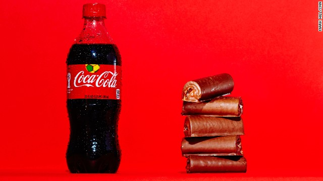 <strong>Soda: Coca-Cola.</strong><!-- --> </br>A 20-ounce bottle of Coca-Cola Classic contains 65 grams of sugar, which is the same amount of sugar found in five Little Debbie Swiss Rolls.