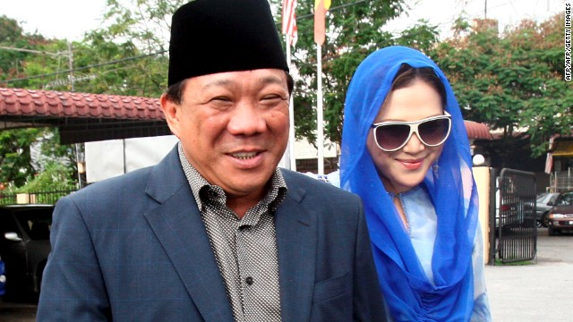 This photo taken on May 19, 2010 shows Malaysian lawmaker Bung Mokhtar Radin, at left, and his second wife Zizie Ezette.
