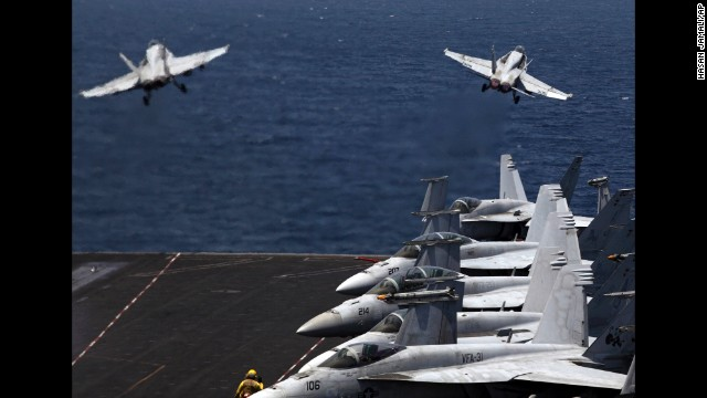 From the flight deck of the USS George H.W. Bush, which is in the Persian Gulf, two U.S. fighter jets take off for a mission in Iraq on Monday, August 11. U.S. President Barack Obama authorized airstrikes against Islamic militants and food drops for Iraqis who are trapped by the militants.
