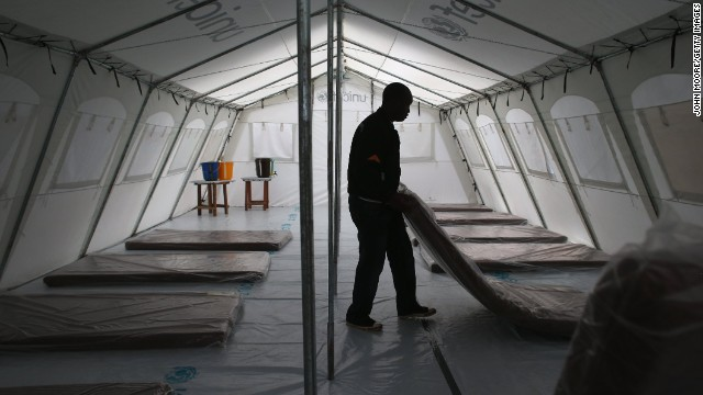 Workers prepare the new Ebola treatment center on August 17.