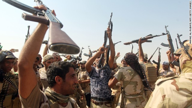 Iraqi volunteer fighters celebrate breaking the Amerli siege on Monday, September 1. ISIS militants had surrounded Amerli, 70 miles north of Baquba, Iraq, since mid-June.