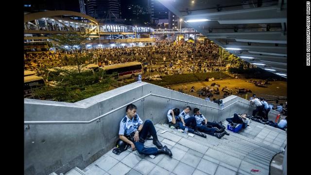 Police officers rest after protests on September 29.