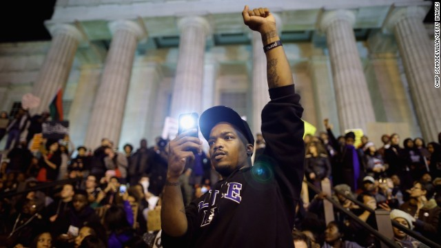 Protesters gather on the steps of the National Portrait Gallery in Washington on Tuesday, November 25. A grand jury's decision not to indict Darren Wilson, a white police officer, in the August shooting death of unarmed black teenager Michael Brown in Ferguson, Missouri, has prompted demonstrations across the country.