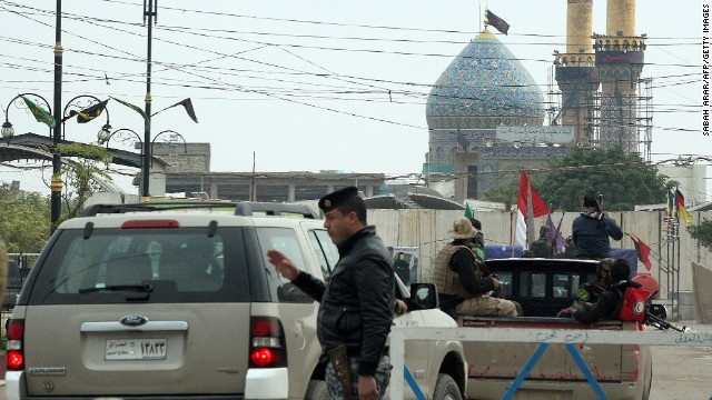 Pro-Iraqi government forces guard a shrine in Balad, Iraq, on Monday, December 15.