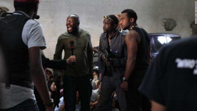 "Musician Wyclef Jean and Akon on the set of Jeta Amata's film ""Black November."""